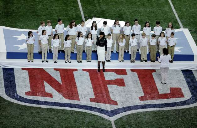 Jennifer Hudson performs with students from Sandy Hook Elementary School before NFL Super Bowl XLVII football game between the San Francisco 49ers and the Baltimore Ravens Sunday, Feb. 3, 2013, in New Orleans. (AP Photo/Charlie Riedel) Photo: Charlie Riedel, AP / Associated Press