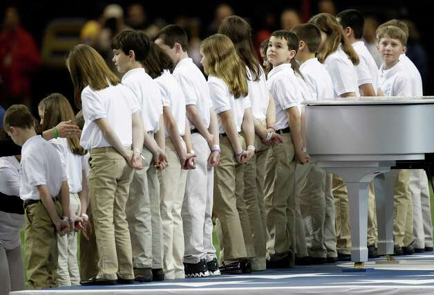 "Students from Sandy Hook Elementary School line up before performing ""America the Beautiful"" before the NFL Super Bowl XLVII football game between the San Francisco 49ers and the Baltimore Ravens Sunday, Feb. 3, 2013, in New Orleans. (AP Photo/Elaine Thompson) Photo: Elaine Thompson, ASSOCIATED PRESS / Associated Press"
