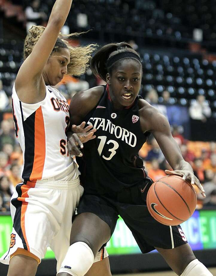Stanford forward Chiney Ogwumike, driving on Oregon State guard Jasmine Camp, scored a career-high 32 points and grabbed 18 rebounds. Photo: Don Ryan, Associated Press