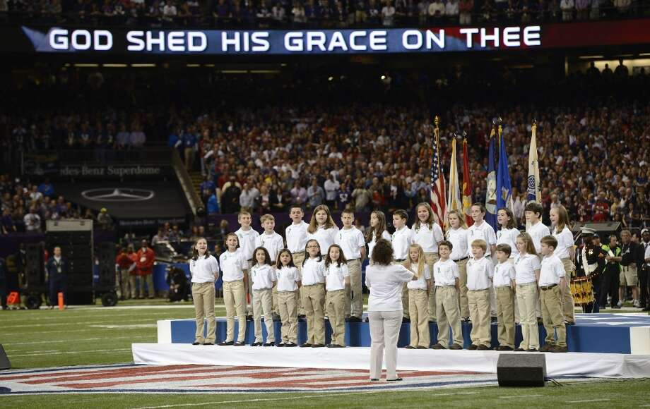 Members of the Sandy Hook Elementary School Chorus sing America The Beautiful  before Super Bowl XLVII between the San Francisco 49ers and the Baltimore Ravens at the Mercedes-Benz Superdome on February 3, 2013 in New Orleans, Louisiana. AFP PHOTO / TIMOTHY A. CLARYTIMOTHY A. CLARY/AFP/Getty Images Photo: TIMOTHY A. CLARY, AFP/Getty Images / AFP