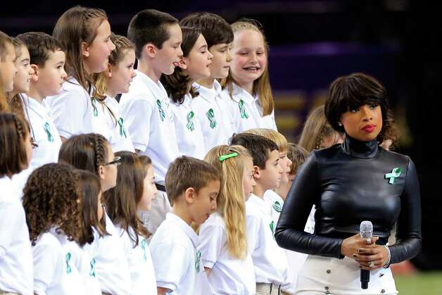 "NEW ORLEANS, LA - FEBRUARY 03:  Singer Jennifer Hudson performs ""America The Beautiful"" with the Sandy Hook Elementary School Chorus prior to the start of Super Bowl XLVII between the San Francisco 49ers and the Baltimore Ravens at the Mercedes-Benz Superdome on February 3, 2013 in New Orleans, Louisiana.  (Photo by Jamie Squire/Getty Images) Photo: Jamie Squire, Getty Images / 2013 Getty Images"