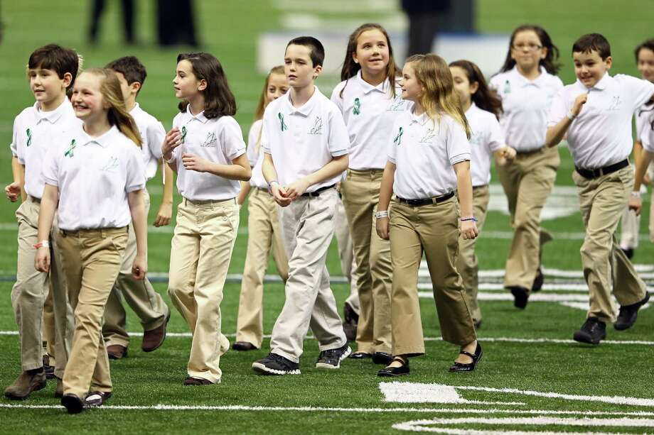 "NEW ORLEANS, LA - FEBRUARY 03: Members of the Sandy Hook Elementary School Chorus walk off the field after singing ""America The Beautiful"" prior to Super Bowl XLVII between the San Francisco 49ers and the Baltimore Ravens at the Mercedes-Benz Superdome on February 3, 2013 in New Orleans, Louisiana.  (Photo by Al Bello/Getty Images) Photo: Al Bello, Getty Images / 2013 Getty Images"