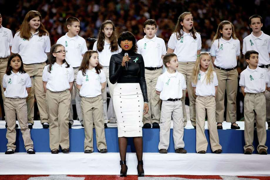 "NEW ORLEANS, LA - FEBRUARY 03:  Singer Jennifer Hudson performs ""America The Beautiful"" with the Sandy Hook Elementary School Chorus prior to the start of Super Bowl XLVII between the San Francisco 49ers and the Baltimore Ravens at the Mercedes-Benz Superdome on February 3, 2013 in New Orleans, Louisiana.  (Photo by Chris Graythen/Getty Images) Photo: Chris Graythen, Getty Images / 2013 Getty Images"