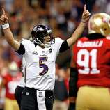 NEW ORLEANS, LA - FEBRUARY 03:  Joe Flacco #5 of the Baltimore Ravens celebrates after throwing a touchdown pass in the first quarter against the San Francisco 49ers during Super Bowl XLVII at the Mercedes-Benz Superdome on February 3, 2013 in New Orleans, Louisiana.