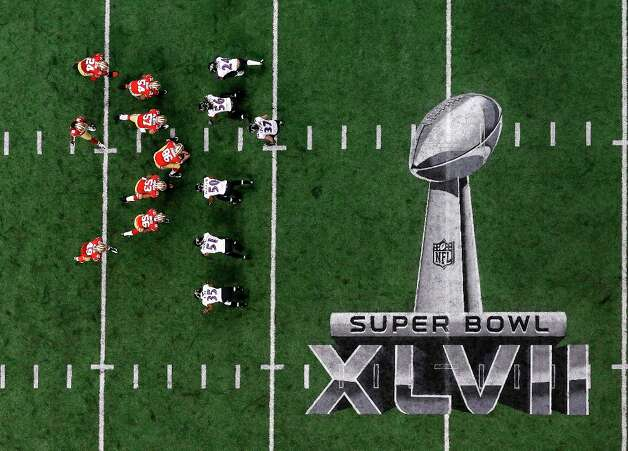 Players line up on the field during the first half of the NFL Super Bowl XLVII football game between the San Francisco 49ers and the Baltimore Ravens Sunday, Feb. 3, 2013, in New Orleans. (AP Photo/Tim Donnelly) Photo: Tim Donnelly, Associated Press / AP