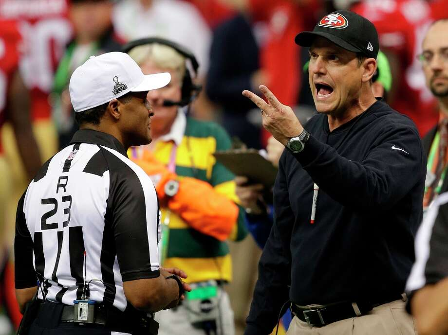 San Francisco 49ers head coach Jim Harbaugh, right, argues with referee Jerome Boger during the first half of the NFL Super Bowl XLVII football game against the Baltimore Ravens, Sunday, Feb. 3, 2013, in New Orleans. (AP Photo/Bill Haber) Photo: Bill Haber, Associated Press / FR170136 AP
