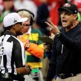 San Francisco 49ers head coach Jim Harbaugh, right, argues with referee Jerome Boger during the first half of the NFL Super Bowl XLVII football game against the Baltimore Ravens, Sunday, Feb. 3, 2013, in New Orleans. (AP Photo/Bill Haber)
