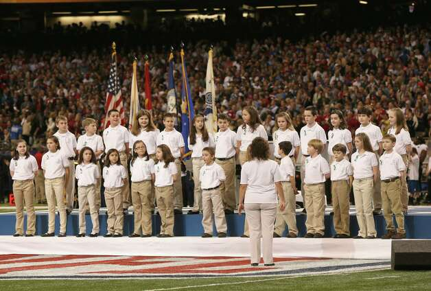 NEW ORLEANS, LA - FEBRUARY 03:  A group of 26 students from the Sandy Hook Elementary School in Newtown, Connecticut perform America the Beautiful  during the Pepsi Super Bowl XLVII Pregame Show at Mercedes-Benz Superdome on February 3, 2013 in New Orleans, Louisiana.  (Photo by Christopher Polk/Getty Images) Photo: Christopher Polk, Getty Images / 2013 Getty Images