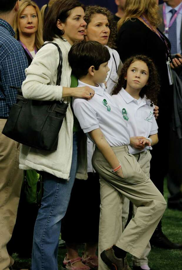 Students from the Sandy Hook Elementary School Choir  on the sidelines with their families before taking the field to sing America the Beautiful with Jennifer Hudson during the pre game show of Superbowl XLVII between the San Francisco 49ers and the Baltimore Ravens at the Mercedes-Benz Superdome on Sunday February 3, 2013 in New Orleans, La. Photo: Brant Ward, The Chronicle / Connecticut Post contributed