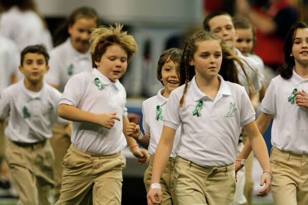 Students from the Sandy Hook Elementary School Choir take the field to sing America the Beautiful with Jennifer Hudson during the pre game show of Superbowl XLVII between the San Francisco 49ers and the Baltimore Ravens at the Mercedes-Benz Superdome on Sunday February 3, 2013 in New Orleans, La. Photo: Brant Ward, The Chronicle / Connecticut Post contributed