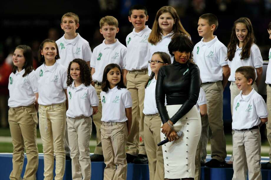 Students from the Sandy Hook Elementary School Choir sing America the Beautiful with Jennifer Hudson during the pre game show of Superbowl XLVII between the San Francisco 49ers and the Baltimore Ravens at the Mercedes-Benz Superdome on Sunday February 3, 2013 in New Orleans, La. Photo: Brant Ward, The Chronicle / Connecticut Post contributed