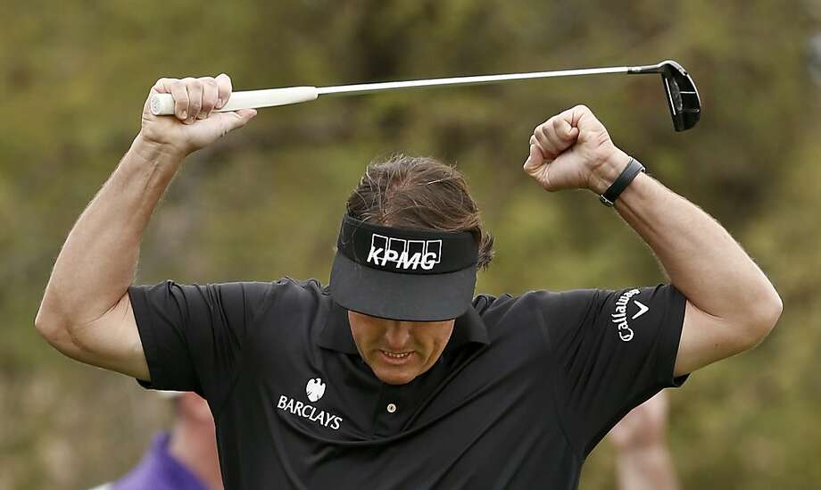 Phil Mickelson is in emphatic mode after draining a long birdie putt on the seventh hole. Photo: Ross D. Franklin, Associated Press