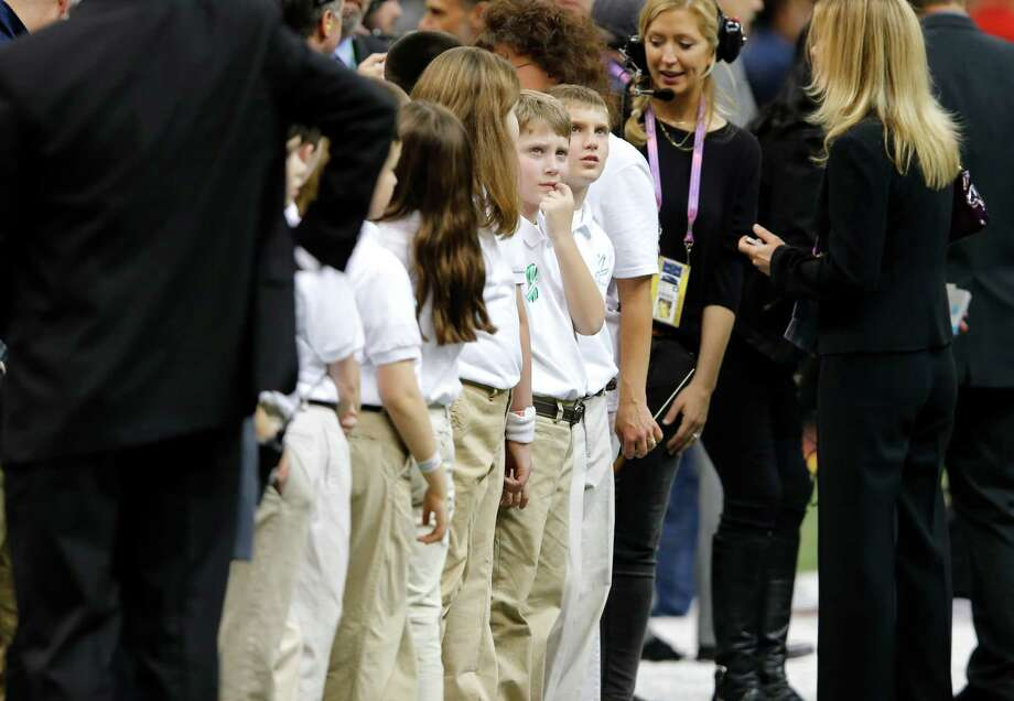 Students from the Sandy Hook Elementary School Choir before taking the field to sing America the Beautiful with Jennifer Hudson during the pre game show of Superbowl XLVII between the San Francisco 49ers and the Baltimore Ravens at the Mercedes-Benz Superdome on Sunday February 3, 2013 in New Orleans, La. Photo: Brant Ward, The Chronicle / Connecticut Post contributed