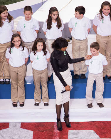 "Jennifer Hudson sings ""America the Beautiful"" alongside the Sandy Hook Elementary School chorus before the start of Super Bowl XLVII at the Mercedes-Benz Superdome on Sunday, Feb. 3, 2013, in New Orleans. Photo: Smiley N. Pool, Chronicle / Connecticut Post contributed"