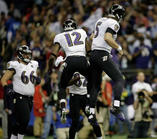 Baltimore Ravens quarterback Joe Flacco (5) and wide receiver Jacoby Jones (12) celebrate a touchdown by tight end Dennis Pitta during the first half of the NFL Super Bowl XLVII football game against the San Francisco 49ers, Sunday, Feb. 3, 2013, in New Orleans. (AP Photo/Evan Vucci) Photo: Evan Vucci, Associated Press / AP