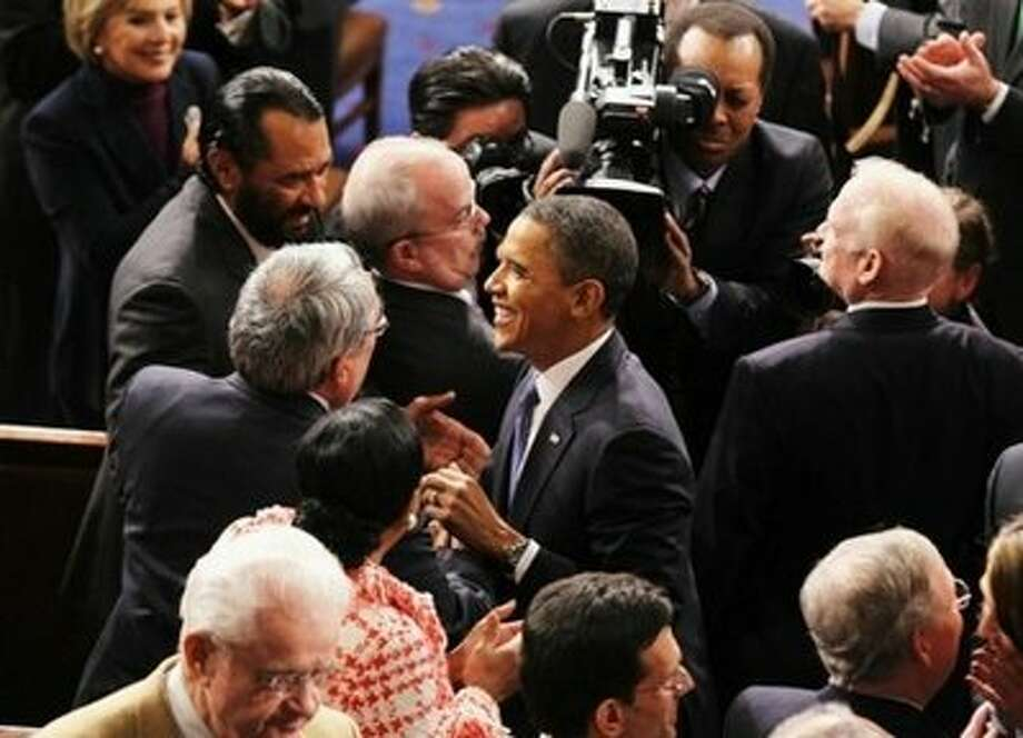 Rep. Al Green of Houston greets President Obama at the 2012 State of the Union address.