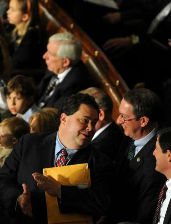 Reps. Blake Farenthold and Quico Canseco chat during their first day in office.