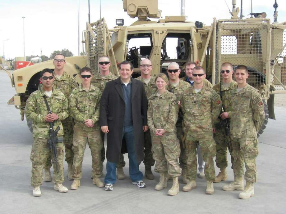 Sen. Ted Cruz poses with service members while traveling on his first congressional delegation trip to Afghanistan and Israel.