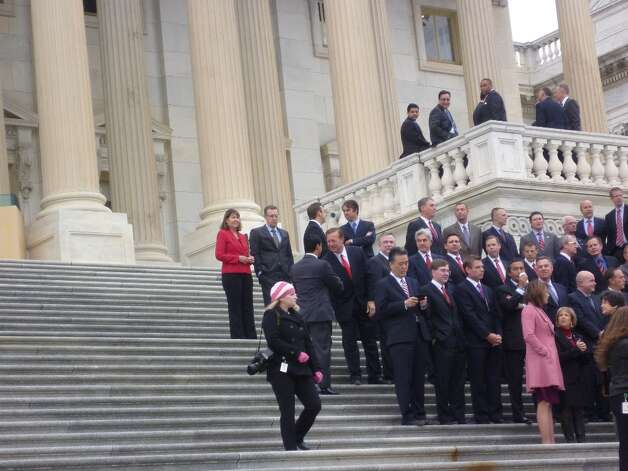 House freshmen congregate on the steps of the Capitol to take their official photo on Nov. 15. Joaquin Castro can be seen greeting fellow congressmen.