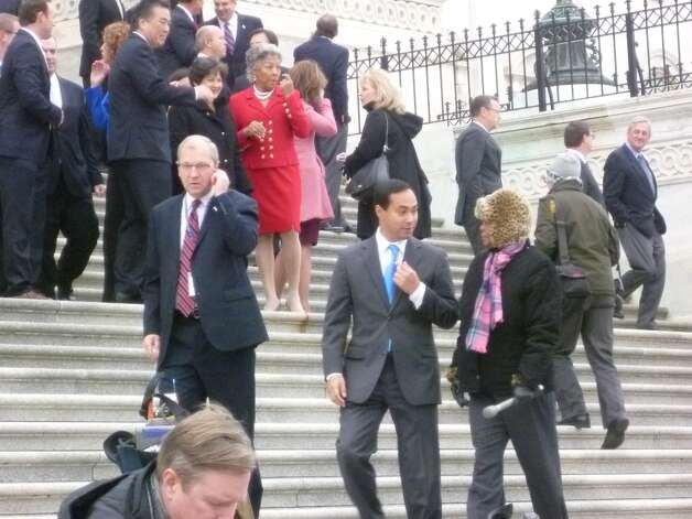 Joaquin Castro chatting with a reporter on the steps of the Capitol.