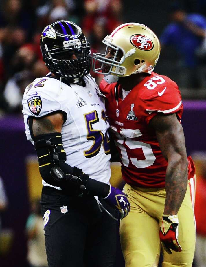 NEW ORLEANS, LA - FEBRUARY 03:  (L-R) Ray Lewis #52 of the Baltimore Ravens and Vernon Davis #85 of the San Francisco 49ers exchange words after Davis made a reception in the second quarter during Super Bowl XLVII at the Mercedes-Benz Superdome on February 3, 2013 in New Orleans, Louisiana. Photo: Harry How, Getty Images / 2013 Getty Images