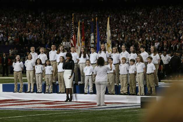 Students from the Sandy Hook Elementary School Choir sing America the Beautiful with Jennifer Hudson during the pre game show of Superbowl XLVII between the San Francisco 49ers and the Baltimore Ravens at the Mercedes-Benz Superdome on Sunday February 3, 2013 in New Orleans, La. Photo: Carlos Avila Gonzalez, The Chronicle / ONLINE_YES