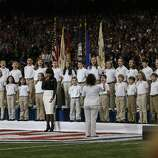 Students from the Sandy Hook Elementary School Choir sing America the Beautiful with Jennifer Hudson during the pre game show of Superbowl XLVII between the San Francisco 49ers and the Baltimore Ravens at the Mercedes-Benz Superdome on Sunday February 3, 2013 in New Orleans, La.