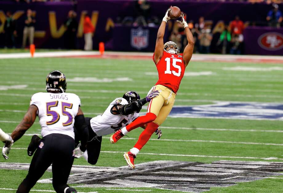 Wide receiver Michael Crabtree (15) catches a pass downfield in the first quarter of Superbowl XLVII between the San Francisco 49ers and the Baltimore Ravens at the Mercedes-Benz Superdome on Sunday February 3, 2013 in New Orleans, La. Photo: Carlos Avila Gonzalez, The Chronicle / ONLINE_YES