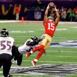 Wide receiver Michael Crabtree (15) catches a pass downfield in the first quarter of Superbowl XLVII between the San Francisco 49ers and the Baltimore Ravens at the Mercedes-Benz Superdome on Sunday February 3, 2013 in New Orleans, La.