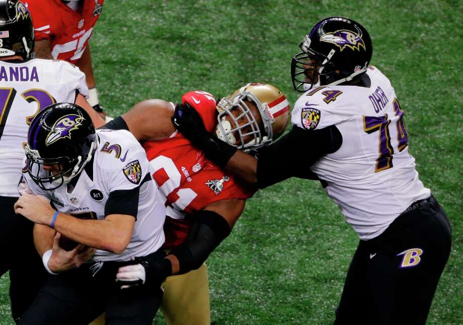 Baltimore Ravens quarterback Joe Flacco (5) is sacked by San Francisco 49ers defensive end Ray McDonald (91) as tackle Michael Oher (74) tries to help during the first half of the NFL Super Bowl XLVII football game Sunday, Feb. 3, 2013, in New Orleans. (AP Photo/Charlie Riedel) Photo: Charlie Riedel, Associated Press / AP