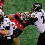 Baltimore Ravens quarterback Joe Flacco (5) is sacked by San Francisco 49ers defensive end Ray McDonald (91) as tackle Michael Oher (74) tries to help during the first half of the NFL Super Bowl XLVII football game Sunday, Feb. 3, 2013, in New Orleans. (AP Photo/Charlie Riedel)