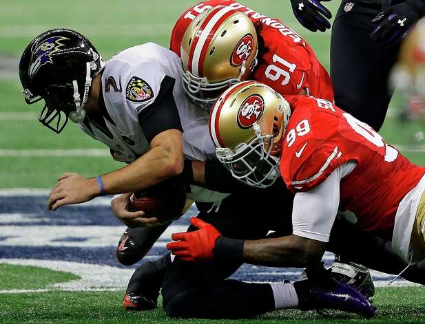 Baltimore Ravens quarterback Joe Flacco (5)  gets sacked by San Francisco 49ers defensive end Ray McDonald (91) as linebacker Aldon Smith (99) helps during the first half of the NFL Super Bowl XLVII football game Sunday, Feb. 3, 2013, in New Orleans. (AP Photo/Elise Amendola) Photo: Elise Amendola, Associated Press / AP