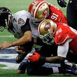 Baltimore Ravens quarterback Joe Flacco (5)  gets sacked by San Francisco 49ers defensive end Ray McDonald (91) as linebacker Aldon Smith (99) helps during the first half of the NFL Super Bowl XLVII football game Sunday, Feb. 3, 2013, in New Orleans. (AP Photo/Elise Amendola)