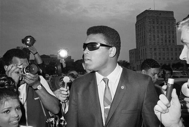"Muhammad Ali is seen outside the Federal Building in Houston after he heard a federal judge tell him to refile his plea to avoid the draft after his scheduled induction, April 27, 1967.  Ali had a ""no comment,"" to questions asked on all subjects. Photo: Ferd Kaufman, ASSOCIATED PRESS / AP1967"