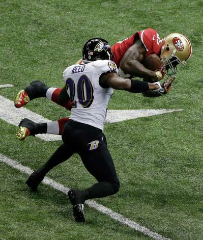 San Francisco 49ers tight end Vernon Davis (85) is tackled by Baltimore Ravens safety Ed Reed (20) during the first half of NFL Super Bowl XLVII football game, Sunday, Feb. 3, 2013, in New Orleans. Photo: Charlie Riedel