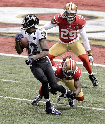 Jacoby Jones (12) of the Baltimore Ravens eludes tacklers Dashon Goldson (38) and Chris Culliver (29) of the San Francisco 49ers and makes his way for a touchdown in the second quarter of Super Bowl XLVII at the Mercedes-Benz Superdome in New Orleans, Louisiana, Sunday, February 3, 2013. (Harry E. Walker/MCT) Photo: Harry E. Walker, McClatchy-Tribune News Service / MCT