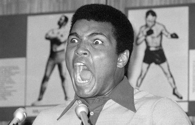 Muhammad Ali makes a face during a press luncheon in New York,  to promote the sale of tickets to Madison Square Garden where the battle against George Foreman in Zaire will be shown in October on closed circuit television. Photo: Ron Frehm, AP / 1974 AP
