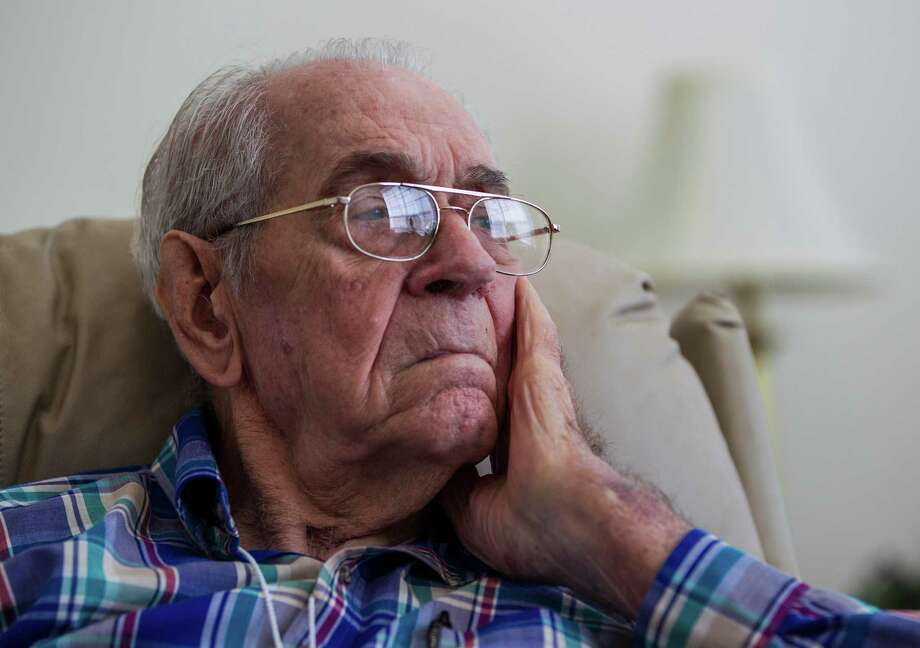 Decorated World War II veteran Elbert Wood, 93, is in a donated room at a senior living center while his vandalized home is being repaired. Photo: Karen Warren, Staff / © 2013 Houston Chronicle