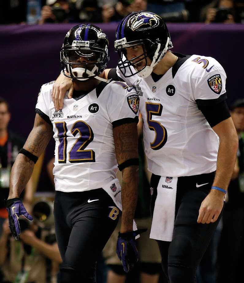 Jacoby Jones and Joe Flacco of the Baltimore Ravens celebrate after a touchdown in the second quarter. Photo: Chris Graythen / 2013 Getty Images