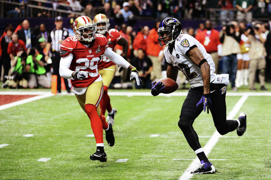 Jacoby Jones of the Ravens scores a 56-yard touchdown in the second quarter. Photo: Harry How / 2013 Getty Images