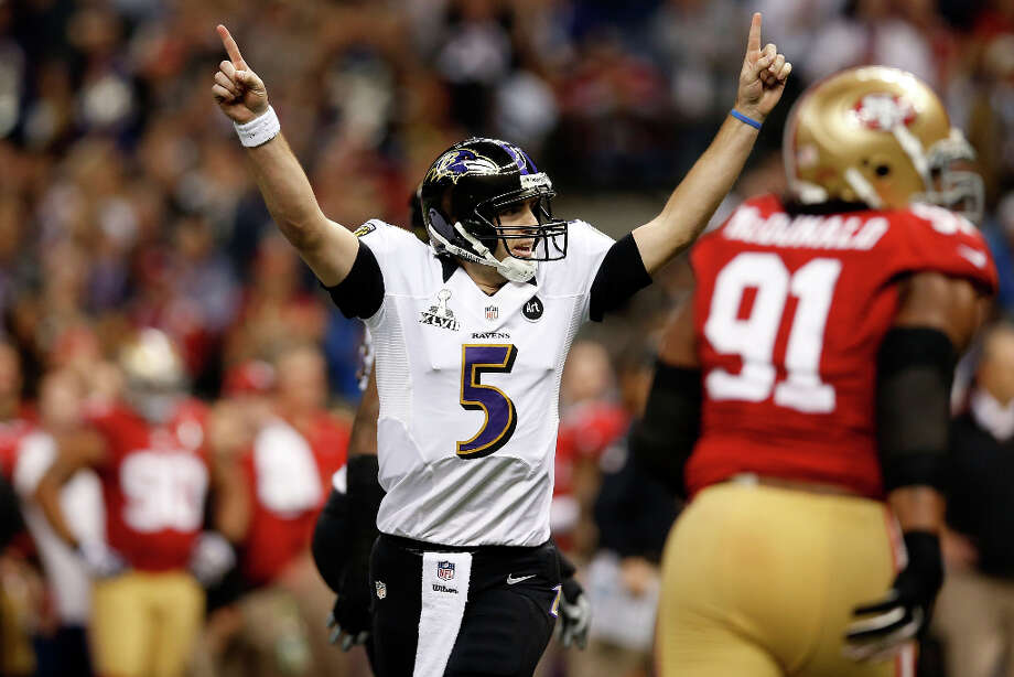 Ravens quarterback Joe Flacco celebrates after completing a touchdown pass. Photo: Chris Graythen / 2013 Getty Images