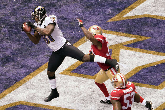 Ravens wide receiver Anquan Boldin (81) catches a 13-yard touchdown pass from Joe Flacco as 49ers strong safety Donte Whitner (31) defends. Photo: Smiley N. Pool, Chronicle / © 2013  Houston Chronicle