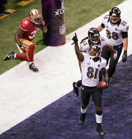 Ravens wide receiver Anquan Boldin (81) celebrates after scoring on a 13-yard touchdown pass from Joe Flacco past 49ers strong safety Donte Whitner. Photo: Smiley N. Pool, Chronicle / © 2013  Houston Chronicle
