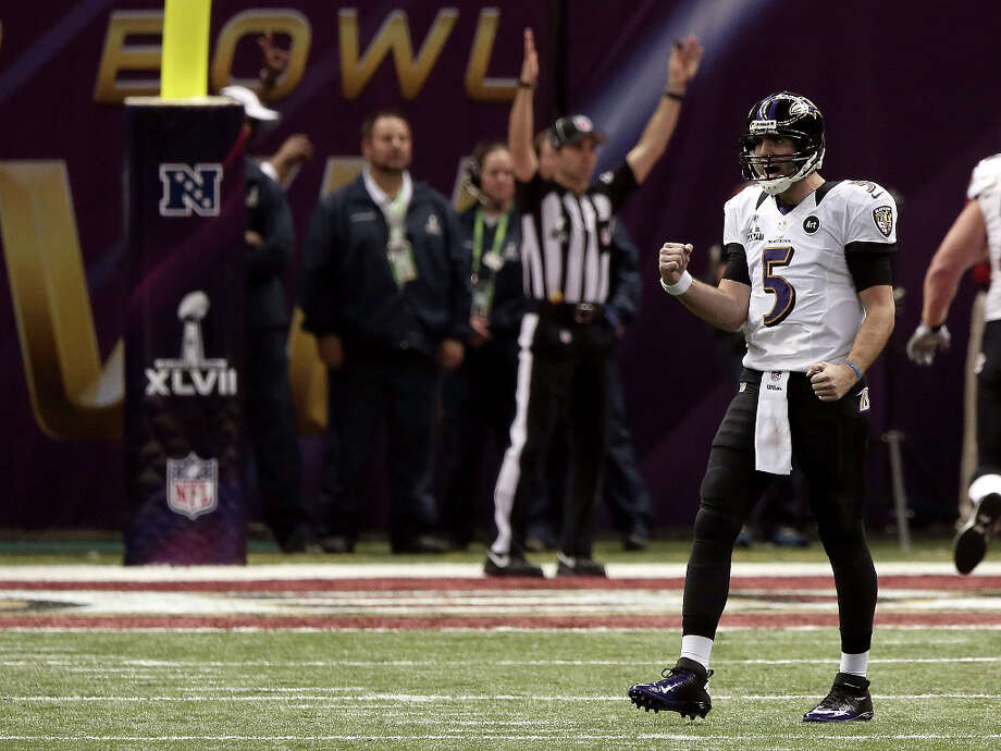 Joe Flacco reacts after throwing a touchdown. Photo: Win McNamee / 2013 Getty Images