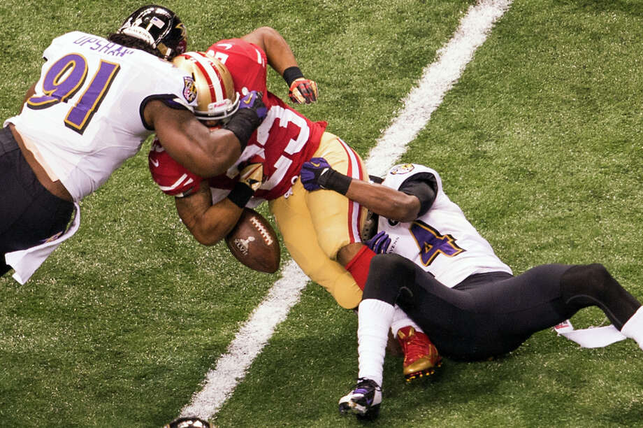 San Francisco 49ers running back LaMichael James (23) fumbles as he is hit by Baltimore Ravens outside linebacker Courtney Upshaw. Photo: Smiley N. Pool / © 2013  Houston Chronicle