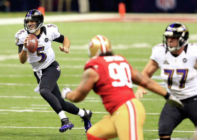 Joe Flacco of the Baltimore Ravens looks to pass during the first quarter. Photo: Jamie Squire / 2013 Getty Images