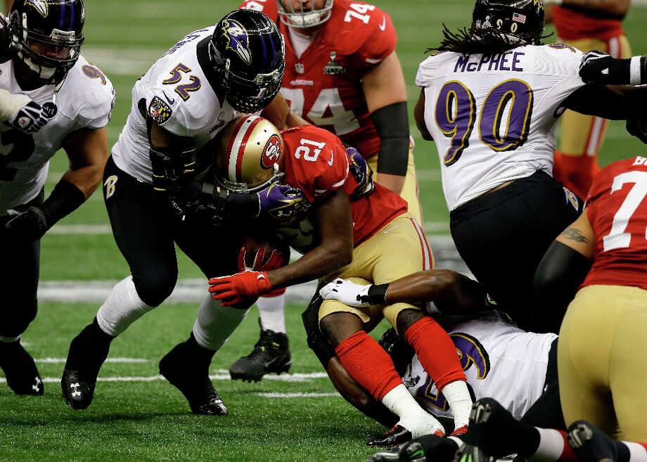 Ravens inside linebacker Ray Lewis tackles San Francisco 49ers running back Frank Gore. Photo: Elise Amendola