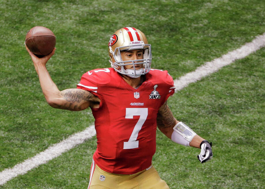49ers quarterback Colin Kaepernick throws a pass during the first half. Photo: Charlie Riedel
