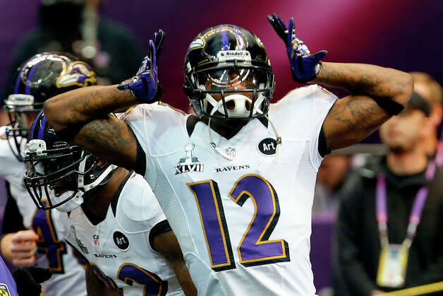Baltimore Ravens wide receiver Jacoby Jones runs onto the field before the NFL Super Bowl XLVII. Photo: Julio Cortez