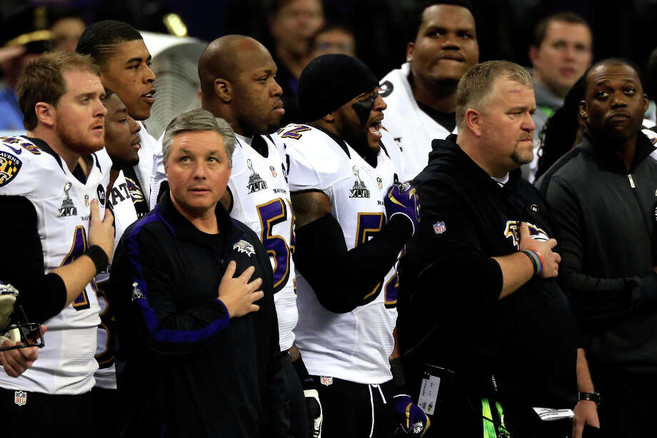 Ray Lewis, Terrell Suggs and members of the Baltimore Ravens listen to the National Anthem. Photo: Jamie Squire / 2013 Getty Images